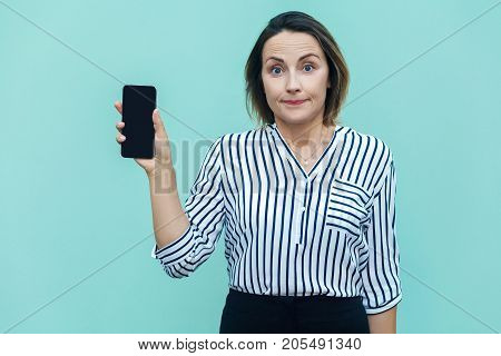 Success Business Woman Showing New Smart Phone And Looking At Camera.