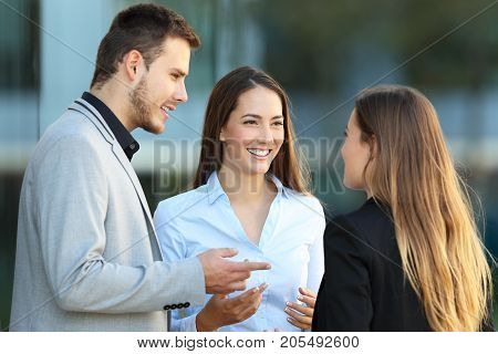 Three Executives Talking On The Street
