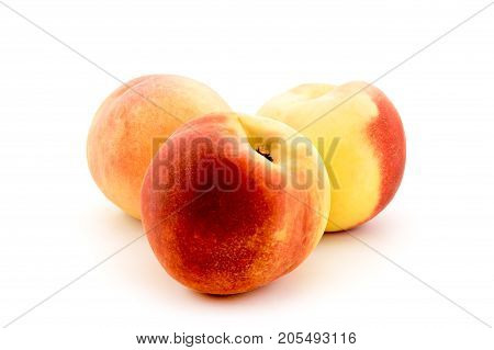 Ripe peaches on a white background, isolated.