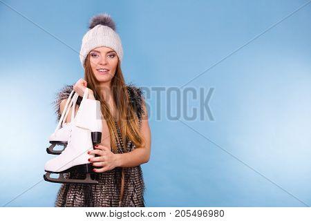 Woman Holding Ice Skates, Winter Sport