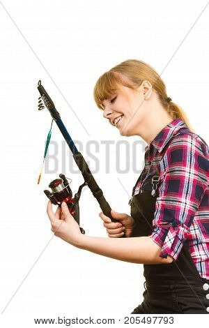 Similing Woman Wearing Check Shirt Holding Fishing Rod