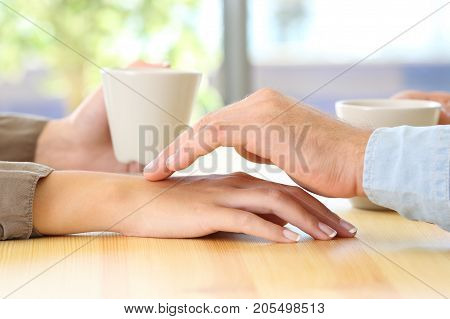 Man Touching The Hand Of His Partner During A Date