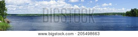 A natural landscape with a lake and clouds. Panorama shooting