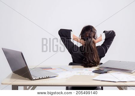 Closeup Portrait Of Cute Young Relaxed Business Woman From Behind With Open Hands Behind Her Head On