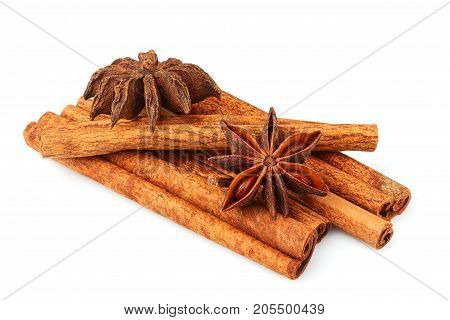 Cinnamon stick and star anise spice isolated on white background.
