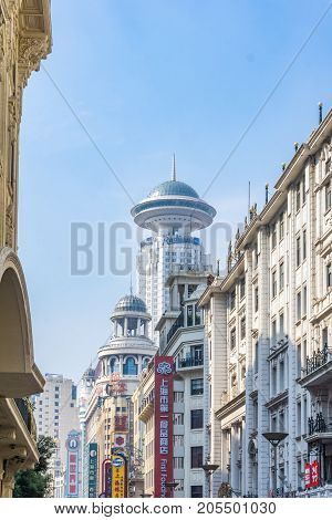 Shanghai, China - Nov 4, 2016: On Nanjing Road Pedestrian Street - Modern buildings in western architectural designs line the metropolitan area.