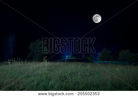 Mountain Road Through The Forest On A Full Moon Night. Scenic Night Landscape Of Dark Blue Sky With