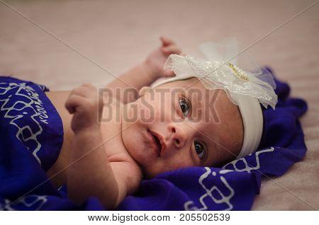 Portrait of a beautiful baby girl. Cute newborn baby close-up. Portrait of a beautiful baby selective focus