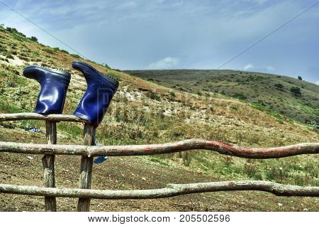 Smoky Mountains With Fence In Foreground. Caucasus Mountains Azerbaijan. Blue Sky