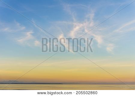 Background Of Small Clouds In Sunset Sky Over The Ocean.