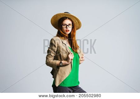 Stylish beautiful woman in a jacket and hat