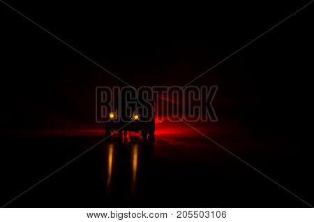 Truck In The Conflict Zone. The War In The Countryside. War Vehicle Silhouette At Night. Battle Scen