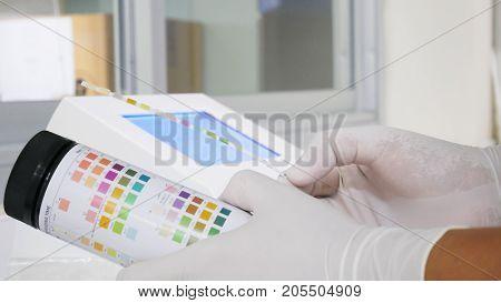 Urine reader meter analysis in withe laboratory.