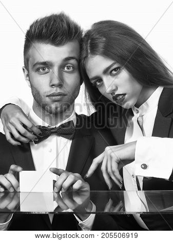 business couple of woman and man hold business card in retro suit jacket and bow black and white