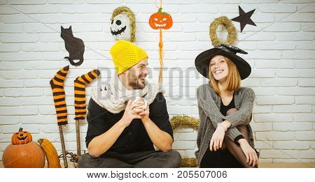 Halloween Couple In Love Smiling On Brick Wall