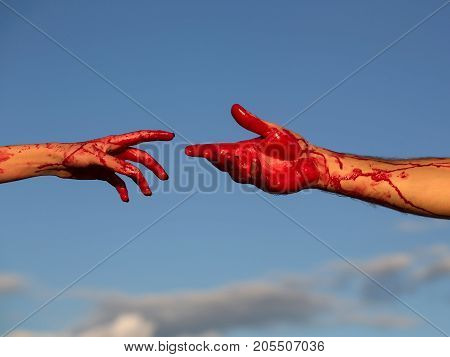 zombie hands male and female of man war soldier and girl or woman with bloody wounds and red blood on skin on blue sky background