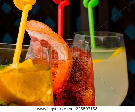 Cocktails On Wooden Background.