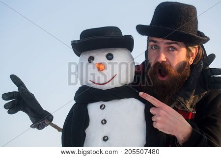 Man And Snowman Pointing Fingers