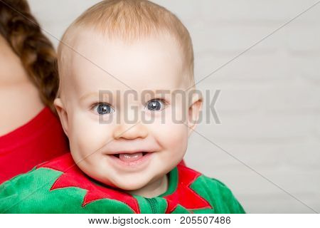 Elf Kid In Costume Of Santa.