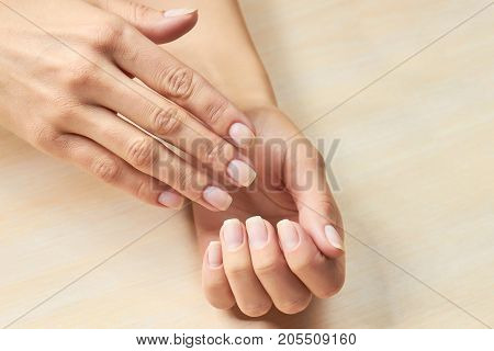 Female hands with clean nails. Girls beautiful healthy hands ready to manicure. Woman hands without varnish on nails.