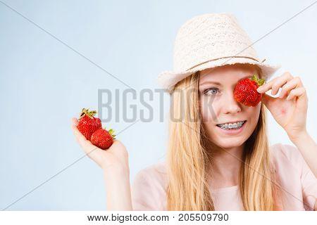 Happy Woman Holding Strawberries