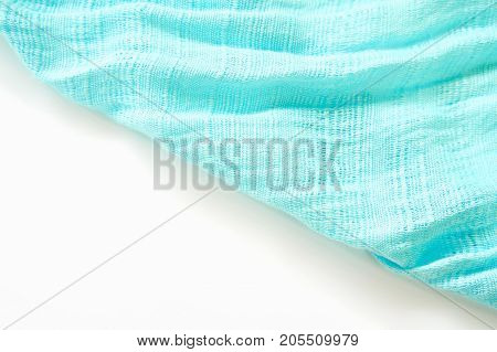 The fabric of the blue scarf. The show is a wave of light and shadow. For to be the background.