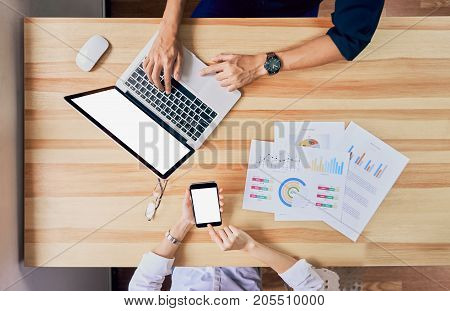 Freelance is brainstorming on work with computer accessories and smartphones. To work faster than ever