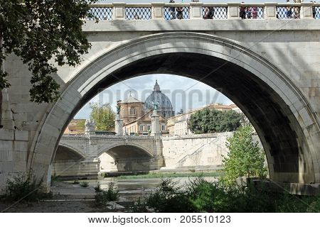 The dome of Saint Peter's as seen from beneath Ponte Sant'Angelo.