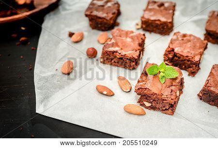 homemade chocolate brownies on dark background, top