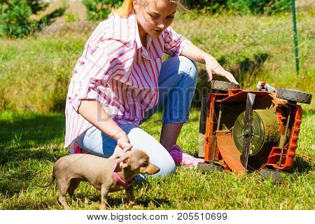 Female Gardener With Broken Lawnmower