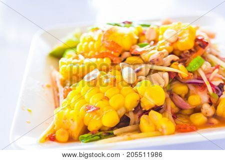 Thai food - corn salad with mixed dried shrimp or dried salted prawn (same papaya salad or som tum thai) - corn salad hot and spicy ( som tum - som tum thai with corn )