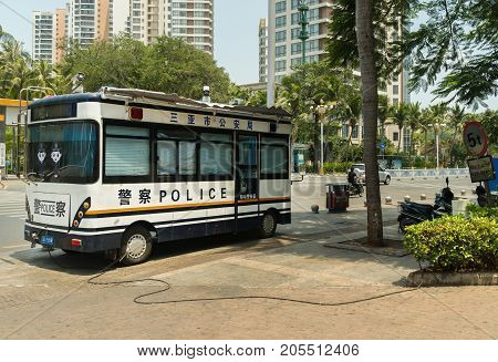 Sanya, China - April 02, 2017: Police bus is charging from the power grid in the tourist city of Sanya