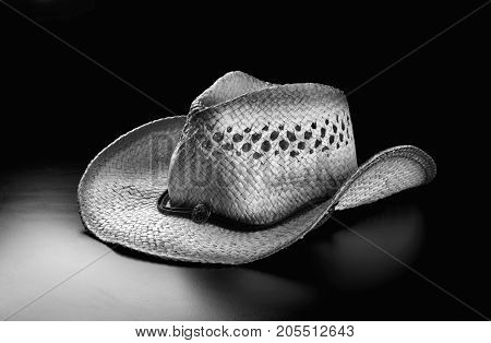 Old straw cowboy hat in black and white..