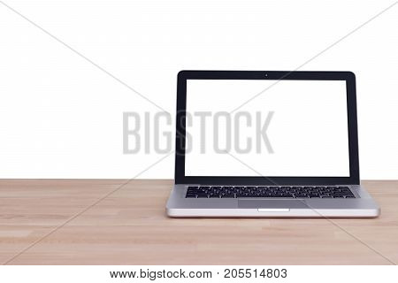 Computer notebook laptop with blank white screen monitor on wood table Isolated on white background with clipping path