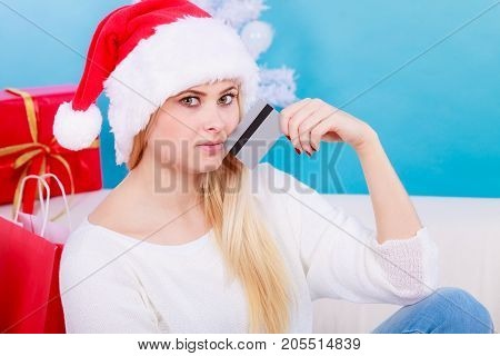 Woman In Santa Hat Holding Credit Card