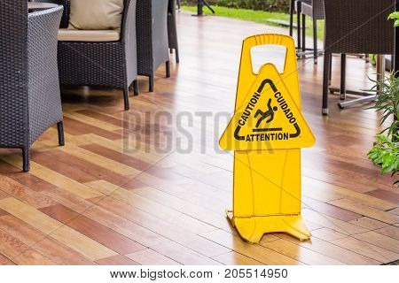 """""""man icon slip on wet floor"""" yellow plastic stand signage for customer to walk carefully on wet floor at mall opened air area after rain poster"""
