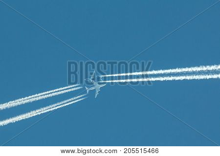 Two passengers jets at the same time in high blue sky, telephoto shot
