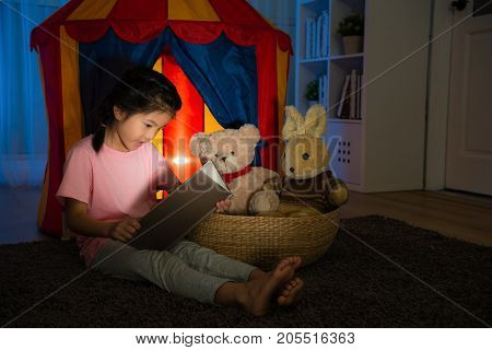 Beautiful Sweet Child Sitting In Front Of Kid Tent