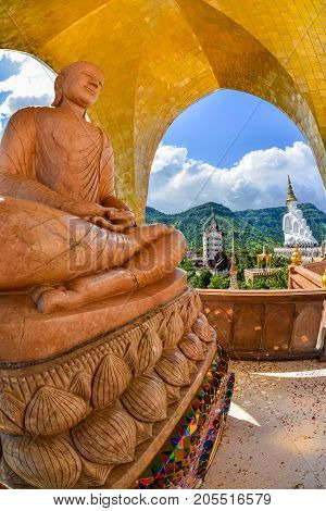 Beautiful brown buddha image with Beautiful white five Buddha Images at Phasornkaew Buddhist temple in Phetchabun, Thailand