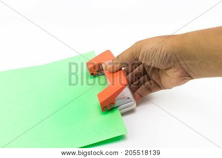 Man Hand Does Using An Orange Paper Punch With Green Paper Isolated