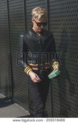 MILAN ITALY - SEPTEMBER 20: Fashionable man poses outside Gucci fashion show building during Milan Women's Fashion Week on SEPTEMBER 20 2017 in Milan.