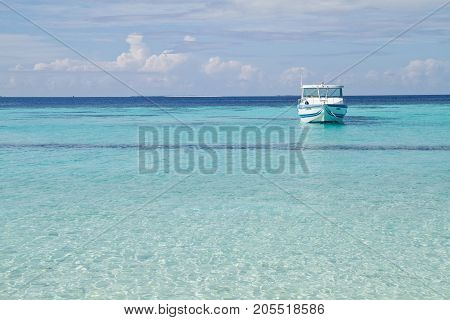 Beautiful beach and sea at Maldives with speedboat on the water