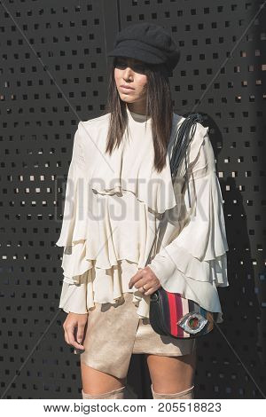 MILAN ITALY - SEPTEMBER 20: Fashionable woman poses outside Gucci fashion show building during Milan Women's Fashion Week on SEPTEMBER 20 2017 in Milan.