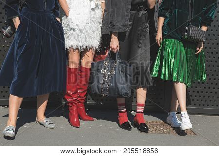 MILAN ITALY - SEPTEMBER 20: Fashionable women pose outside Gucci fashion show building during Milan Women's Fashion Week on SEPTEMBER 20 2017 in Milan.