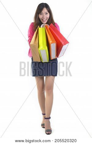 Shopping young asian women holding shopping bags on white studio background.(Sale and promotion concept)