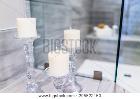 Closeup Of Staging Modern Stone Grey Tiled Bathroom In Model Home, Apartment Or House With Candles,