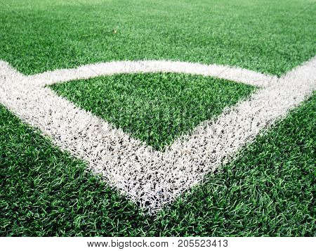 corner football. close up corner of white line paint on green synthetic lawn football,soccer field. outdoor sport concept