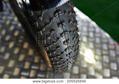 Tread Of Tire With Grooves Molded For Motorcycle Wheel