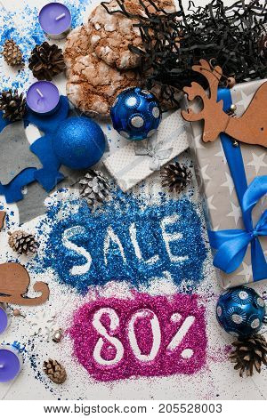 Sales on Christmas and New Year holidays, top view reversed. Festive decoration with informative inscription of 80 pct discount for shop-windows, shopping malls and advertizing background concept