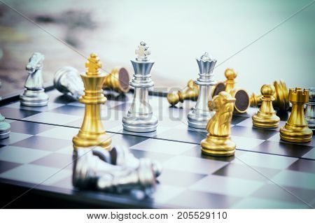 abstract scene of check mate on golden king in chess game with vintage filter - can use to display or montage on product